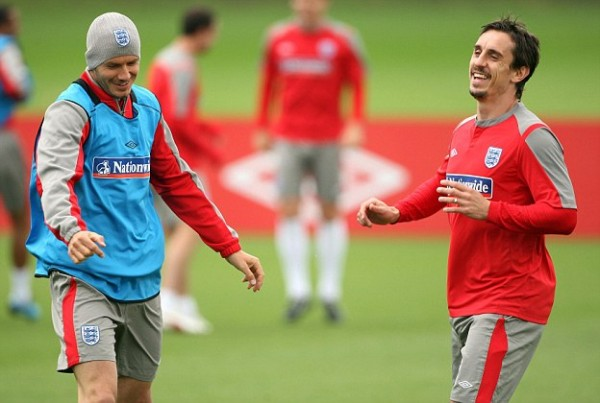 In the Line of Duty: Beckham and Gary Neville.