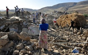 Rescue teams search for victims in the earthquake-stricken village of Varzaqan near Ahar, in the East Azerbaijan province