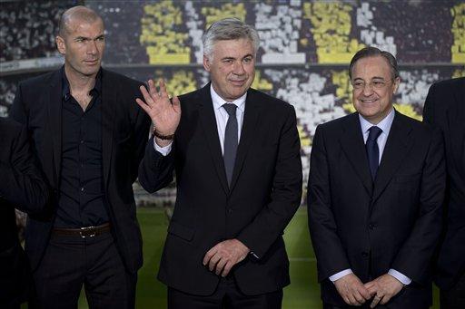 Ancelotti Waves During His Presentation as Real Madrid Manager In the Company of Zinedine Zidane and Florentino Perez. Image: AP Photo/Daniel Ochoa de Olza.