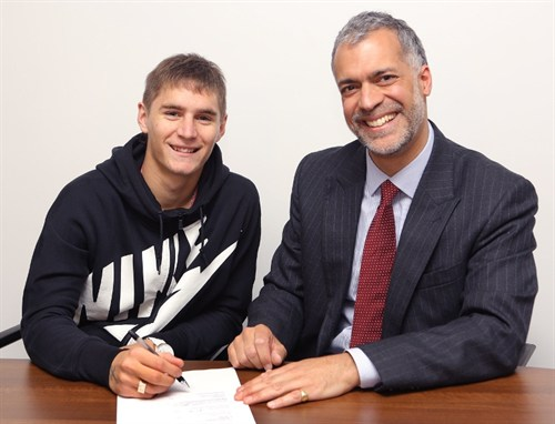 Guillermo Varela Puts Pen to Paper Alonside United's Chief Operating Officer Michael Bolingbroke.