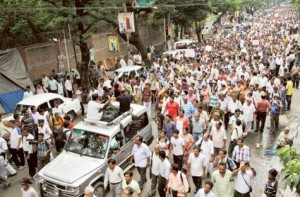 People march in large number through a street to protest against rape and atrocities committed against women in Kolkata, India.