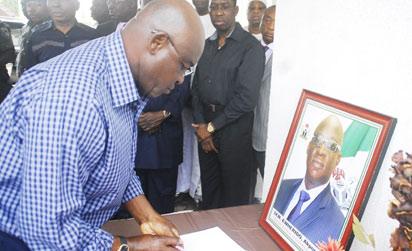 Senate President, Senator David Mark signing condolence register of Late Senator Pius Akpor Ewherido at his residence in Abuja