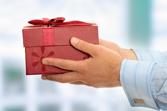 Man Giving Woman Gift 300x200