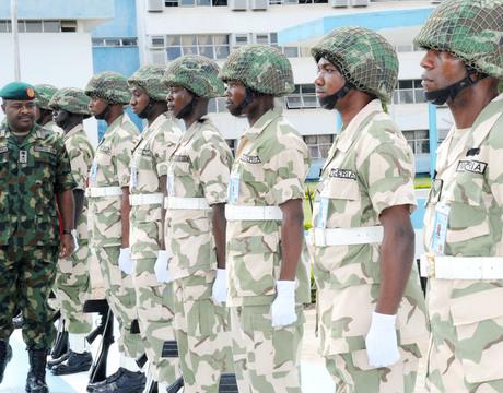 CHIEF OF ARMY STAFF, LT.-GEN. AZUBUIKE IHEJIRIKA (L), INSPECTING  PARADE OF GUARDS IN KADUNA ON MONDAY