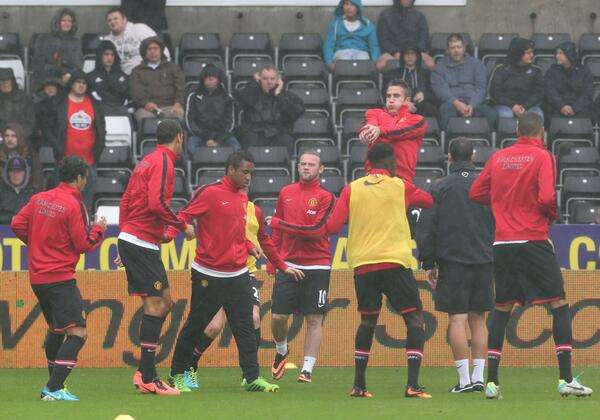 Rooney and Teammates Warm Up Before Opening Day Match Against Swansea.