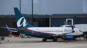 Flight-diverted-after-passenger-attempts-to-open-plane-door-mid-air