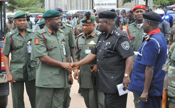 CHIEF OF ARMY STAFF, LT.-GEN AZUBUIKE IHEJIRIKA, BEING RECEIVED BY THE POLICE & NSCDC OFFICIAL AT THE SCENE OF A BLAST THAT ROCKED UN HOUSE IN ABUJA IN 2011