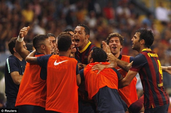 Adriano Celebrates With Teammates After Getting the Match Winner.
