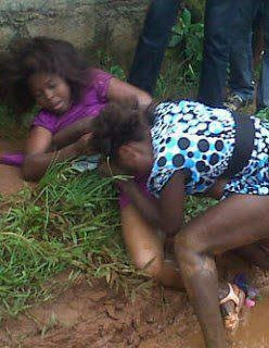 See This Two Beautiful Ladies Fighting Publicly In The Mud