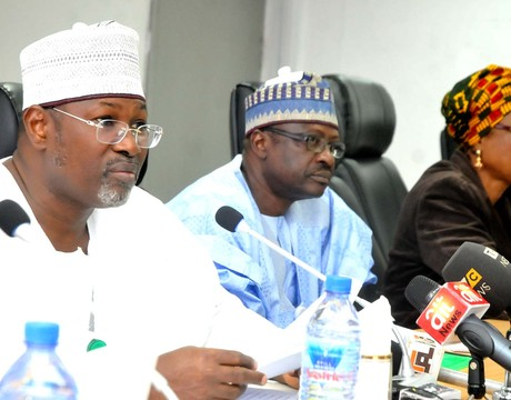 INEC NATIONAL CHAIRMAN, PROF. ATTAHIRU JEGA (L), ADDRESSING MEMBERS OF POLITICAL PARTIES DURING INEC 3RD QUARTERLY CONSULTATIVE MEETING IN ABUJA ON  TUESDAY (24/9/13). WITH HIM ARE THE INEC NATIONAL COMMISSIONERS DR CHRIS IYIMOGA (M) AND DAME GLADYS NWAFOR