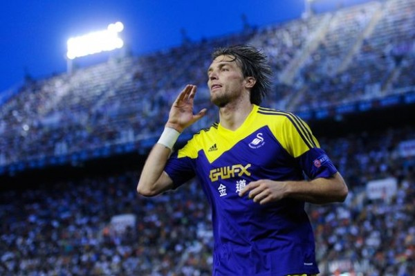 Trademark: Miguel Michu Celebrates Scoring Against Valencia.