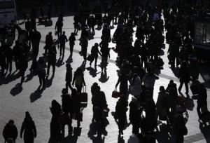 Passengers waiting to board trains crowd Beijing Railway Station