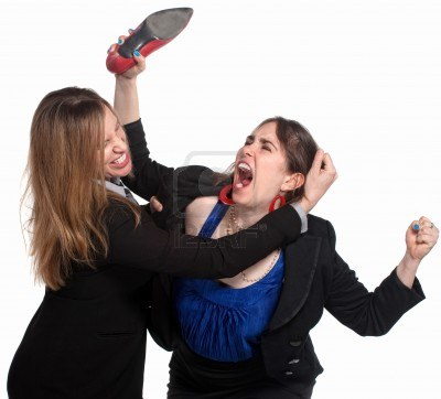 14383275-two-professional-woman-fighting-over-white-background