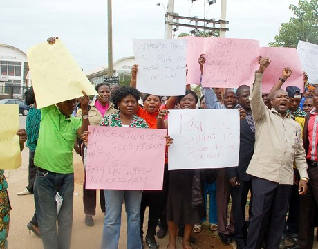NIPOST WORKERS PROTESTING OVER NON-PAYMENT OF THEIR ALLOWANCES IN ABUJA ON WEDNESDAY. PHOTO CREDIT: NAN