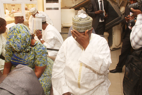SOME OF THE PENSION THIEVES INCLUDING DR. TEIDI SHUAIBU COVER THEIR FACES IN SHAME AS THEY ARE LED OUT OF A COURT IN ABUJA