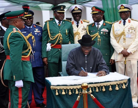 PRESIDENT GOODLUCK JONATHAN, SIGNING THE ANNIVERSARY REGISTER, DURING  THE PRESIDENTIAL CHANGE OF GUARDS PARADE,  AT THE PRESIDENTIAL VILLA IN ABUJA ON  TUESDAY (1/10/13).