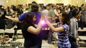 attendees of the sunday assembly playing a game