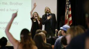 British comedians and co-founders of the Sunday Assembly, Sanderson Jones, right, and Pippa Evans sing a song at the Sunday Assembly in Los Angeles photo:AP