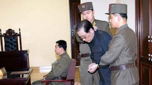 Jang Song-Thaek (2nd-R) being escorted in court on December 12, the day of his execution.  AFP PHOTO