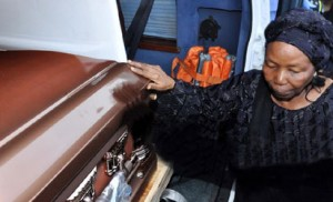 Widow of Solomon Lar, Mary, blessing her husband's remains at the airport reception in honour of Late Solomon Lar in Abuja on Friday Solomon Lar's widow, Mary, by her husband's remains at the Abuja airport