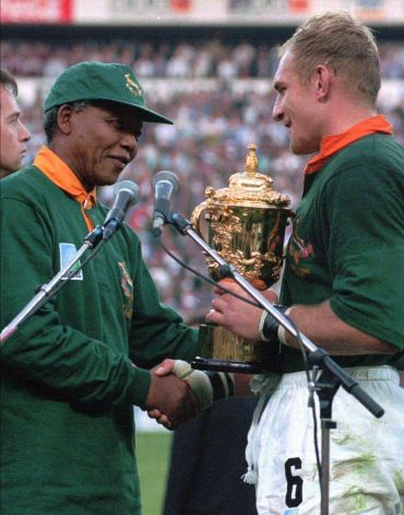 The Late Mandela Presents the 1995 Rugby World Cup Trophy to Springboks Captain Pienaar.