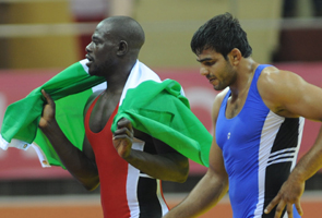 Joe Agbonevbare of Edo State Walks With His National Flag After Defeating Manoj Kumar of India in the 84  kg Men's.
