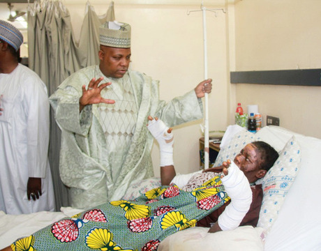 GOV. KASHIM SHETTIMA OF BORNO, SPEAKING WITH OF ONE THE YET TO BEDISCHARGED VICTIMS OF THE JANUARY 14, MAIDUGURI BOMB BLAST AT THE UNIVERSITY OF MAIDUGURI TEACHING HOSPITAL WHEN THE GOVERNOR UNDERTOOK A SECOND VISIT ON WEDNESDAY (22/1/14) TO REASSESS THE STATE OF THE VICTIMS.