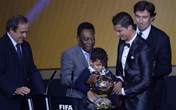 Cristiano Ronaldo (Sr and Jr) Receives the 2013 Ballon d'Or Award from Michael Platini and Pele.