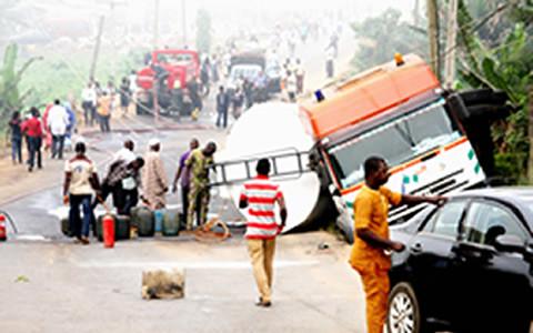 THE CRASH SCENE ON AJUWON ROAD, IJU IN LAGOS ... ON THURSDAY. CREDITS: STANLEY OGIDI