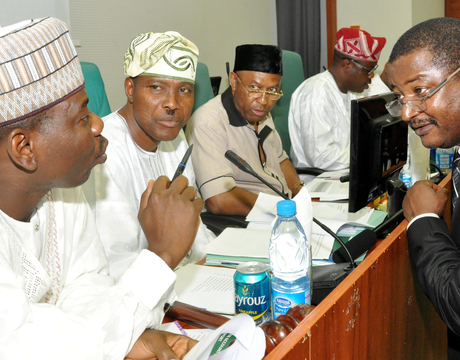 FROM LEFT:NNPC, GROUP MANAGING DIRECTOR, MR ANDREW YAKUBU (R), WITH MEMBERS OF THE HOUSE JOINT COMMITTEE ON PETROLEUM RESOURCES DOWNSTREAM, UPSTREAM AND JUSTICE, INVESTIGATING THE ALLEGED CONNIVANCE OF NNPC WITH SWISS OIL DEALERS TO ROB NIGERIA IN ABUJA ON TUESDAY (25/2/14).