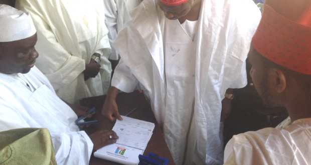 GOV. RABI'U MUSA KWANKWASO OF KANO STATE (CENTRE) BEING REGISTERED AS APC MEMBER BY THE KANO STATE CHAIRMAN OF THE APC REGISTRATION COMMITTEE, DR. MUSTAPHA INUWA, IN HIS WARD AT KWANKWASO TOWN ON THURSDAY