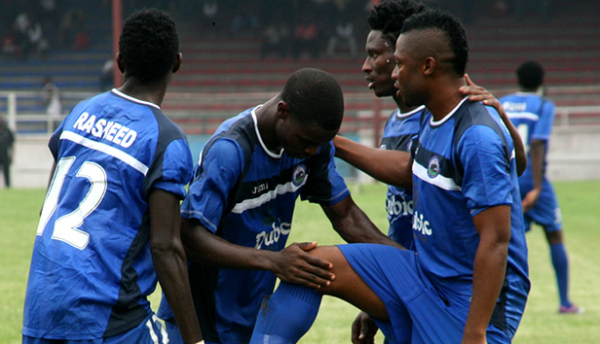 Sibi Gwar Celebrates With Teammates During a Glo Premier League Match.