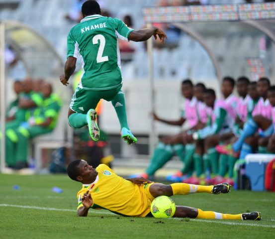 Solomon Kwambe Dodges a Challenge from a Zimbabwean Opponent During the Third Place Match Between Both Teams.