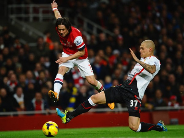 Tomas Rosicky Will Remain at the Emirates Stadium Until 2016 after Signing a One-year Contract Extension Earlier in the Year- Wenger.