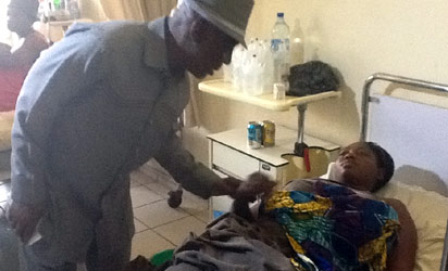 EX-INTERIOR MINISTER, ABBA MORO WITH ONE OF THE INJURED VICTIMS AT THE NATIONAL HOSPITAL, ABUJA