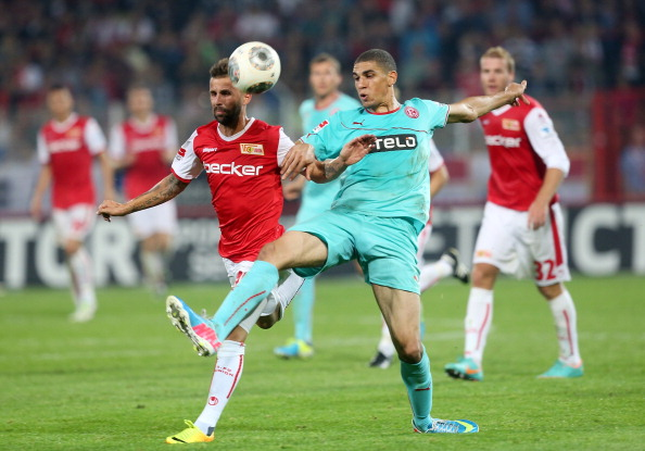 Leon Balogun Battles the Ball With Benjamin Koehler of Hertha Berlin During a German Bundesliga Match. Getty Image.