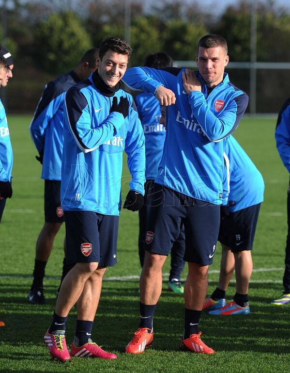 Mesut Ozil and Lukas Podolski During Arsenal Training.