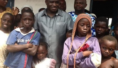 NAFDAC DG, DR. PAUL ORHII WITH SOME OF THE DISPLACED CHILDREN