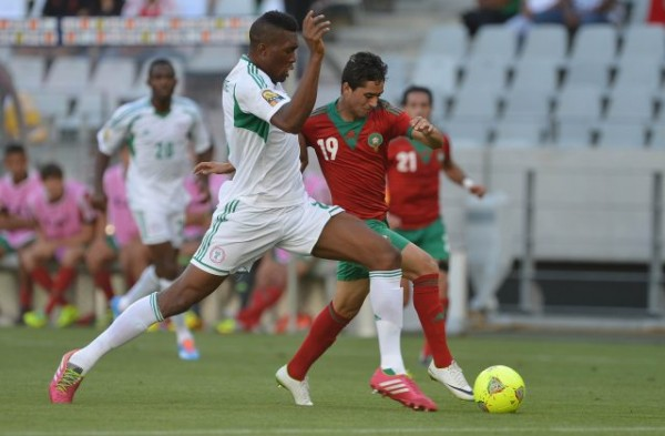 Azubuike Egwuekwe Tussles for the Ball With A Moroccan Player In a CHAN 2014 Match.