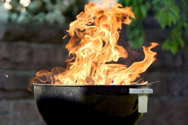 Raging-fire-from-charcoal-barbecue-grill