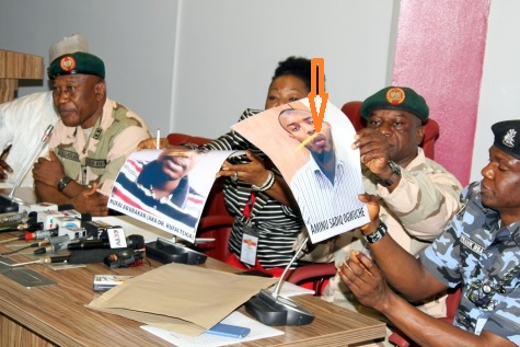 SECURITY AGENCIES AT A JOINT PRESS BRIEFING IN ABUJA ON MONDAY (ENLARGED PHOTO OF AMINU OGWUCHE ARROWED)