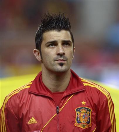 David Villa Honours the Spanish National Anthem Before A 2014 WOrld Cup Qualifying Match Against Finland in March 2013. REUTERS/Vincent West