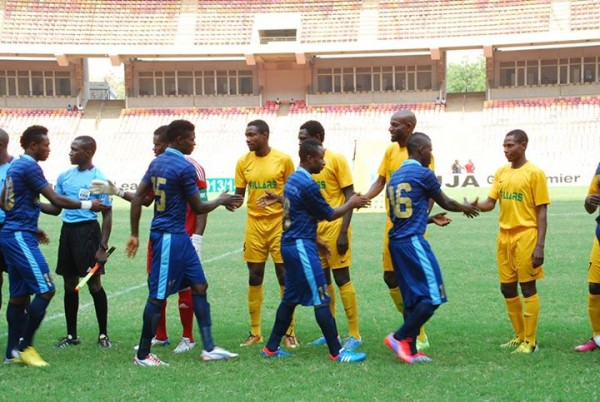 Kano Pillars Players Exchanges Pleasantries With Their Bayelsa United Counterparts During the Super Four Tourney in Abuja.