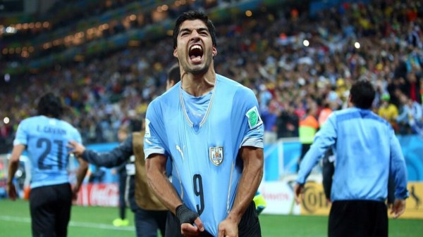 Luis Suarez Celebrates His Brace Against England at the World Cup. Getty Image.