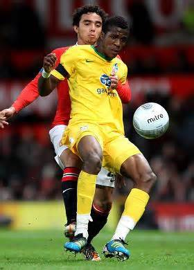 Wilfried Zaha Challenged By Rafael Da Silva During a League Cup Game in 2012.