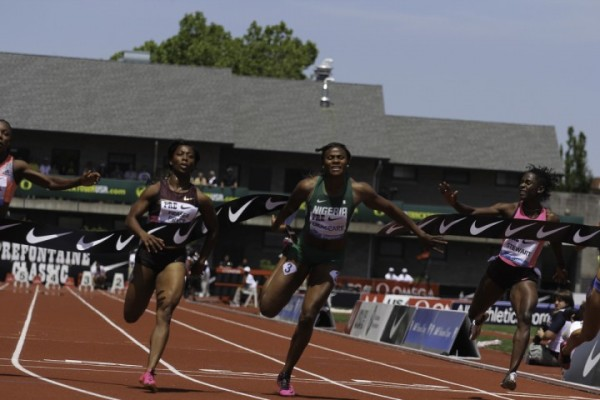 Fraser-Pryce Crossing the Line Ahead of Okagbare at the 2913 Pre Classic. Image: AP.