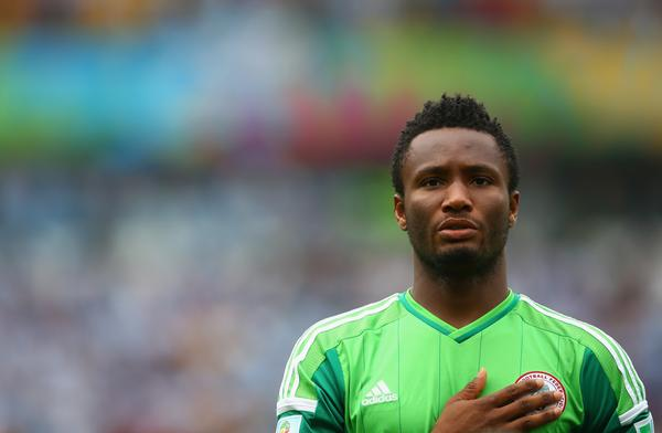 John Mikel Obi Observes the National Anthem Pre-Game Ritual Ahead of a Game in South Africa in 2014. Image: AFP.