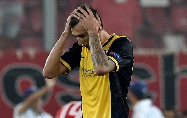 Mario Mandzukic Broke His Nose During Atletico's 3-2 Loss at Olympiakos. Image: ARIS MESSINIS/AFP/Getty Images
