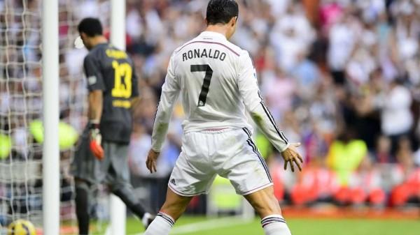 Cristiano Ronaldo Celebrates Scoring a Penalty Against Barcelona. Image: Getty.