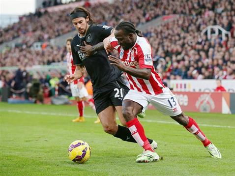 Victor Moses Tries to Beat Burnley's George Boyd at the Britannia. Image: Stoke City via Action Image.